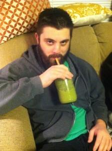 Boyfriend drinks green smoothie